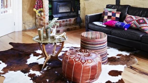The leather pouf gives this space a definite Moroccan vibe.