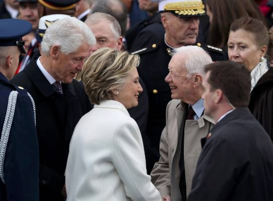 Former Democratic presidential candidate Hillary Clinton and former U.S. President Jimmy Carter greet each other as ...
