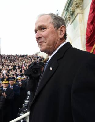 Former U.S. President George W. Bush arrives for the Presidential Inauguration of Trump at the U.S. Capitol in ...