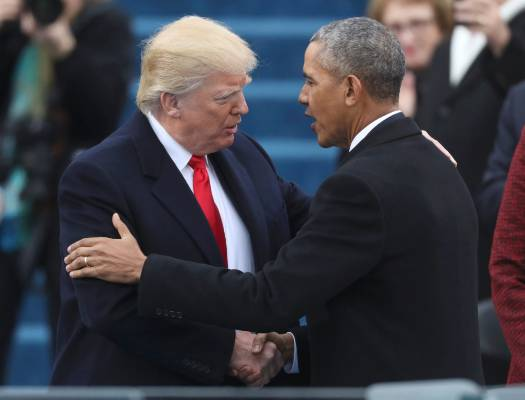U.S. President-elect Donald Trump greets outgoing President Barack Obama (R) before Trump is inaugurated during ...