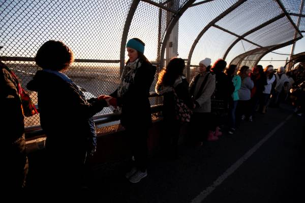 Women of the Boundless Across Borders organization hold hands during a bi-national protest called Braiding Borders at ...