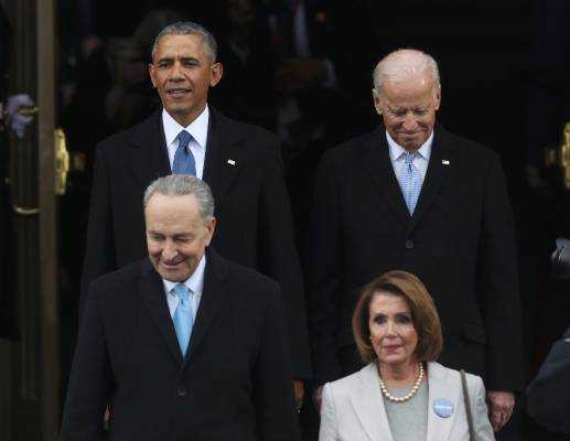 U.S. President Barack Obama (rear, L) and Vice President Joe Biden (rear, R) arrive for the inauguration ceremonies for ...