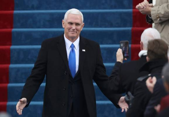 U.S. Vice President-elect Mike Pence arrives for his inaguration as well as that of President-elect Donald Trump on the ...