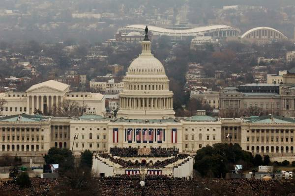 Attendees partake in the inauguration ceremonies to swear in Donald Trump as the 45th president of the United States at ...