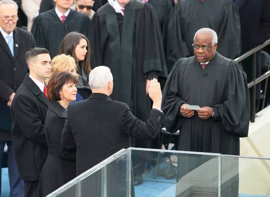 U.S. Vice President Mike Pence is sworn in by Supreme Court Justice Clarence Thomas during inauguration ceremonies in ...