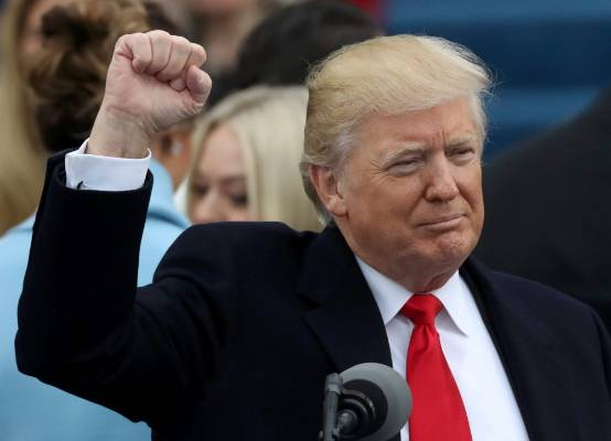 US President Donald Trump raises his fist after being sworn in as the 45th president of the United States.