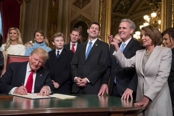 President Donald Trump is joined by the Congressional leadership and his family as he formally signs his cabinet ...