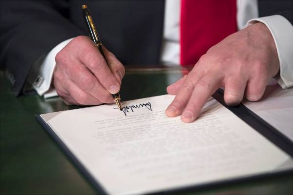 US President Donald Trump formally signs his cabinet nominations into law.