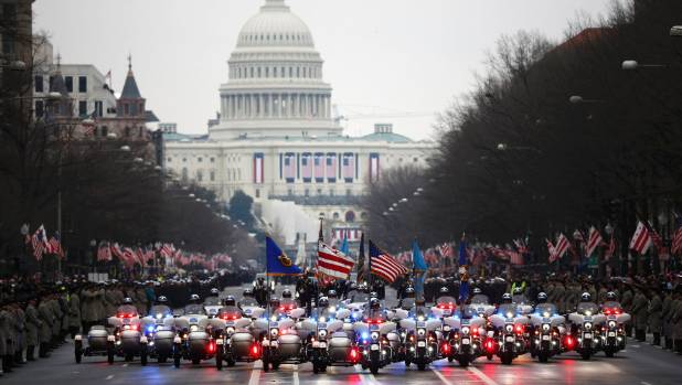 The presidential motorcade makes its way along Pennsylvania Ave in Washington DC following the swearing in of Donald ...