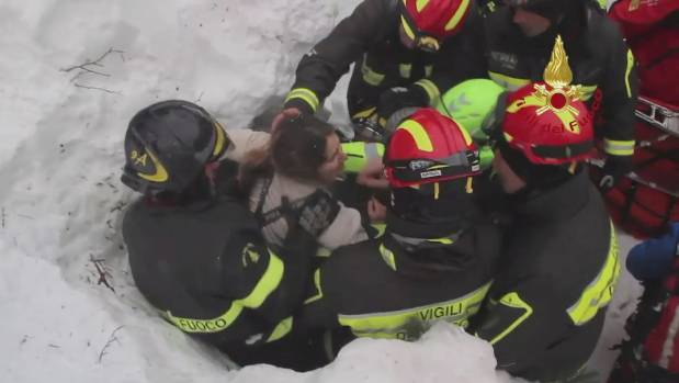 Ten pulled alive from avalanche hotel in Italy after snow created 'igloo'