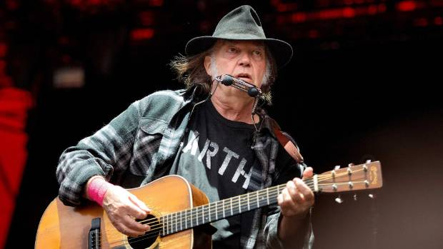 Neil Young performs at the Orange Stage at the Roskilde Festival in Roskilde, Denmark, during his tour last year to ...