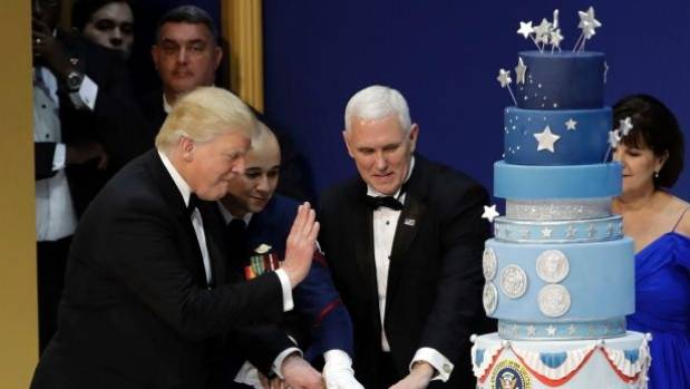 President Donald Trump and Vice President Mike Pence cut the cake.
