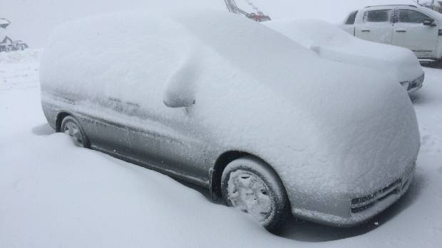 A car covered in snow at the Cardrona Alpine Resort.
