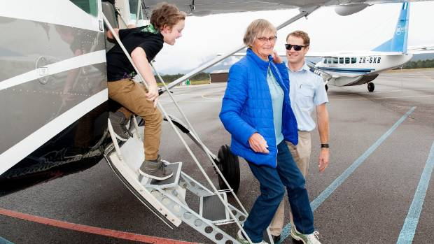 Air Milford operations manager and pilot Antony Sproull with his airline's first paying passengers between Queenstown ...
