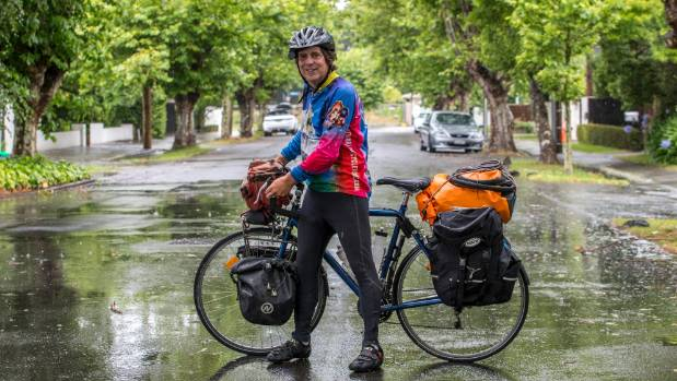 Dr Scott Acton with his bike in Christchurch.