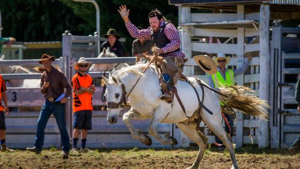 Joe Redwood from Rangiora is pictured competing in the 2nd division saddle bronc at the Winchester Rodeo in 2016.