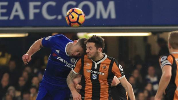 Ryan Mason of Hull City and Gary Cahill of Chelsea collide during the Premier League match between Chelsea and Hull City.