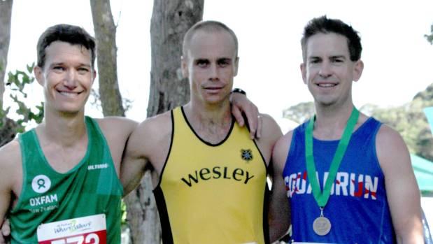 Second place winner Matt Carroll, from Kingsland, and third place's Sam Corbett from Mt Albert flank winner Tom Moyes.