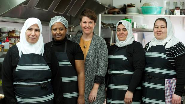 Rebecca Stewart, with some of the team at Pomegranate Kitchen, will speak about her work helping to upskill former refugees.