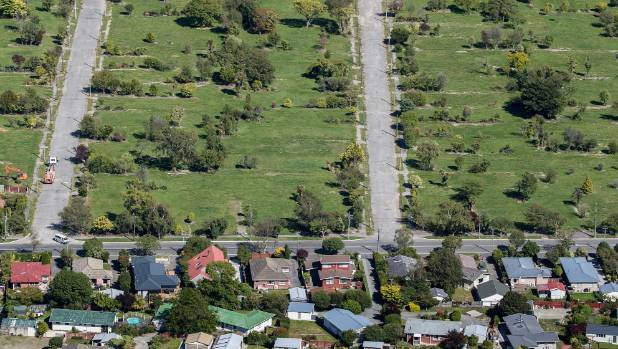 Christchurch's residential red zone on one side of the street, housing on the other.