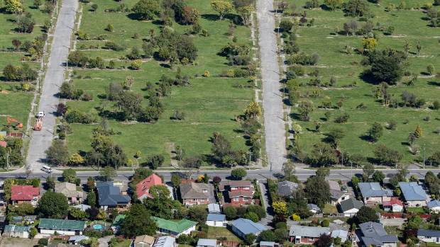 The residential red zone on one side of the street, housing on the other.