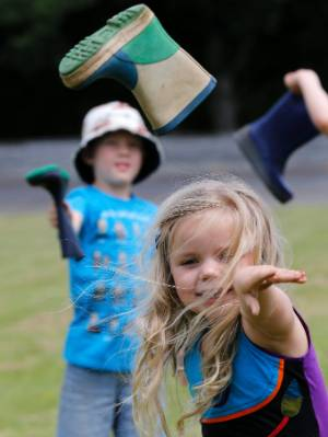 Emily Tiffen, 3, practices her gumboot throwing.