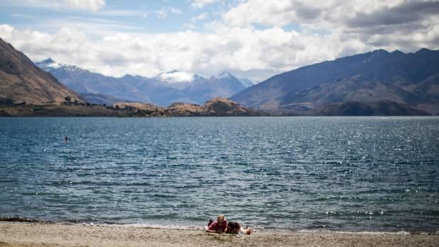 Tourists on the shore of Lake Wanaka.
