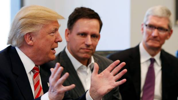 The now US President Donald Trump meets with Thiel, centre, and Apple chief executive Tim Cook, at Trump Tower in December.