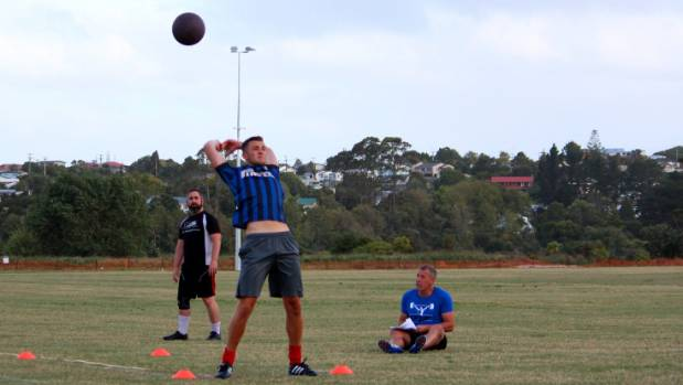 Players hurl medicine balls with results recorded by Karl Hopman and Rick Hyde as Hibiscus Coast AFC players ready for ...