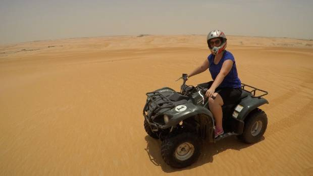 Quad biking in the Western region's desert.