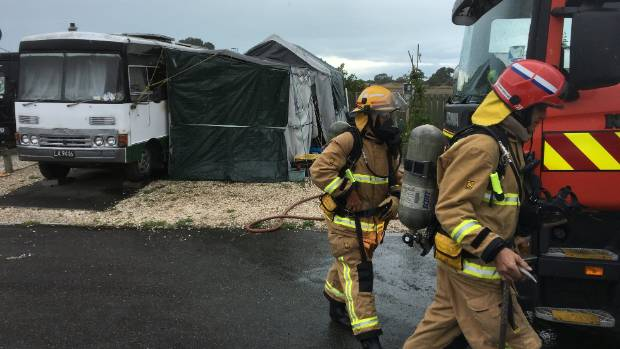 Firefighters at the scene of the motorhome fire at the Tahuna Beach Holiday Park.
