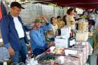Areni Wine Festival promoter Armen Khalatyan, left, of the boutique Old Bridge Winery helps run their stall at the festival.