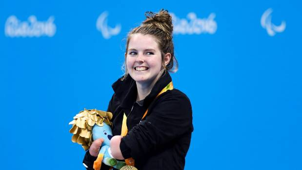 Nikita Howarth stands on the podium after winning her gold medal at the Rio Paralympics.