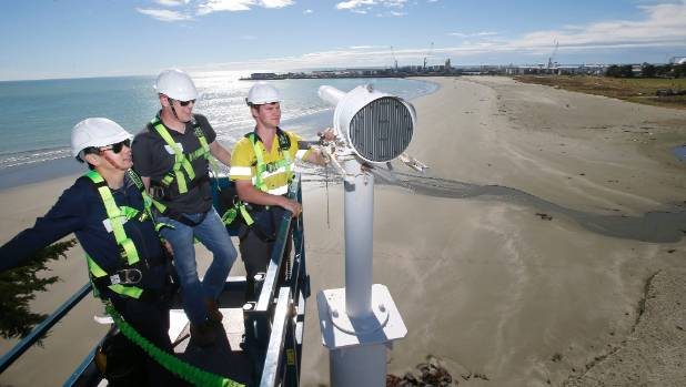 Vega Industries workers Jin Zhang, Chris Cooper and Luke Joyce install the new port entry light installed in Timaru on ...