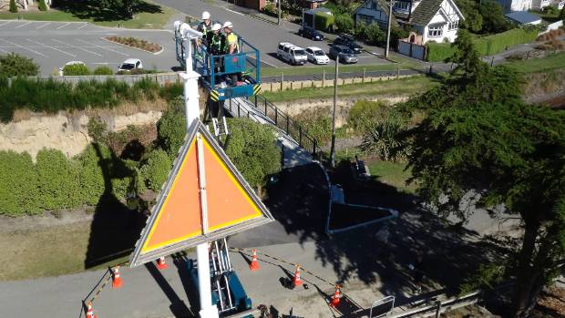Vega Industries workers install the new port entry light installed in Timaru on Thursday.