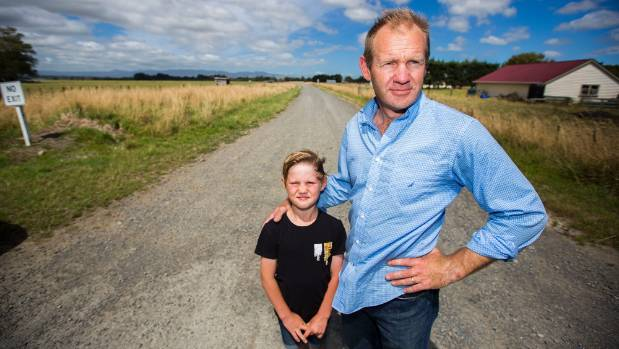 Carl Smith and his son Hugo Smith, 6, took action after spotting an unattended grass fire in a paddock spreading toward ...