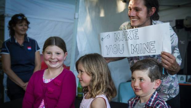Charlotte Bull, 10, Madison Sewell-Monod, 7, and Patrick Bull, 7, get an autograph from Benny Tipene.