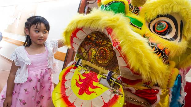 Honor Zhao, 4 was smitten with the fluffy Chinese lion.