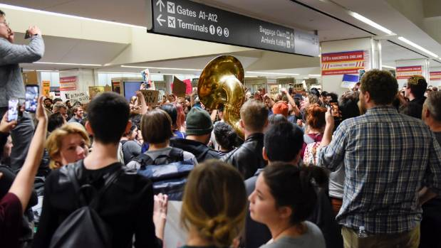 Demonstrators swarm RDU in protest of Trump travel ban