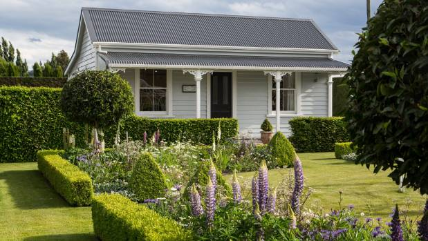 Dave and Sue Monahan painted their mid-1800s cottage in an old Taubmans colour 'Grey Gum', the same shade as their villa ...