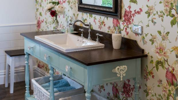 Sue drew up the plans for the bathroom vanity and Dave built it at his furniture manufacturing company.