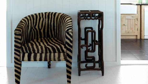 The zebra hide chair was a find from Blue Moon; the umbrella stand next to it was Tina's grandfather's.