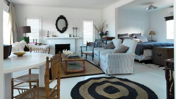 The two rugs in the living area of Tina Symman's Hawkes Bay cottage were put down to protect the white flooring.