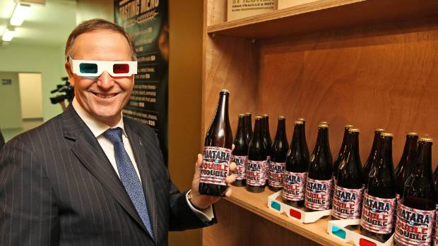 Former prime minister John Key checks outs the brew 'Double Trouble' at the opening of the Tuatara Brewery in Paraparaumu.