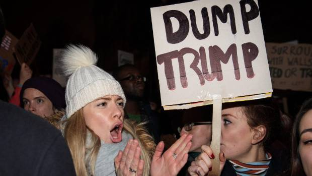 A demonstrator chants during a protest outside Downing Street against US President Donald Trump's ban on travel from ...