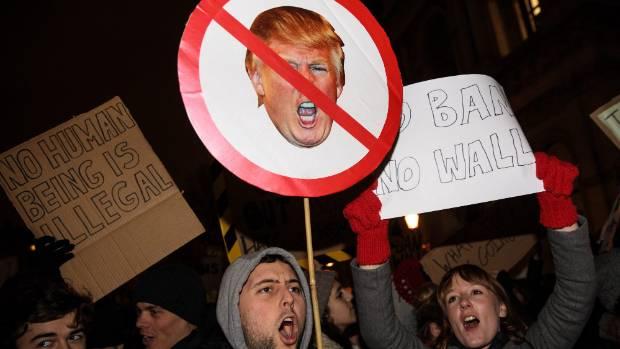 Demonstrators in Britain protest Donald Trump's Muslim ban.