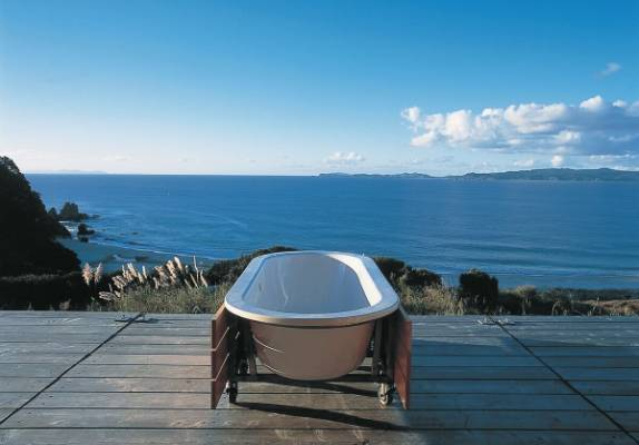 The bach also features a mobile bathtub that can be wheeled out onto the deck for the ultimate bathing spot.