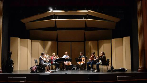 "Artists rehearsing in the ""sound shell"" created in Nelson's Theatre Royal under the direction of  Marshall Day Acoustics ..."