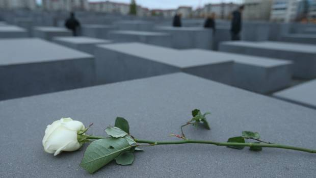A white rose lies on one of the 2,711 stellae at the Holocaust Memorial in Berlin, Germany.