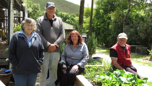 Waitomo's Te Toko Station is a family business. From left Judy, Kim, Janette and Bob Osborne with Jack the dog.    .